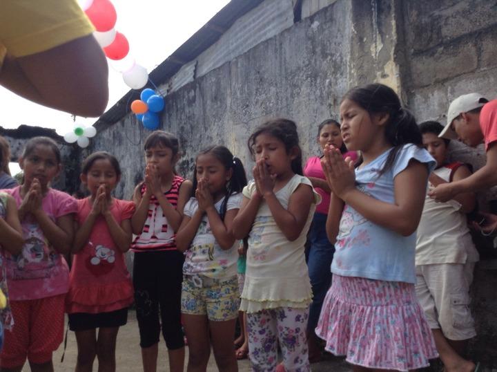 girls praying together
